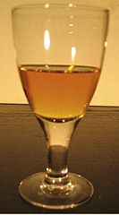 Cordial glass with golden liquid