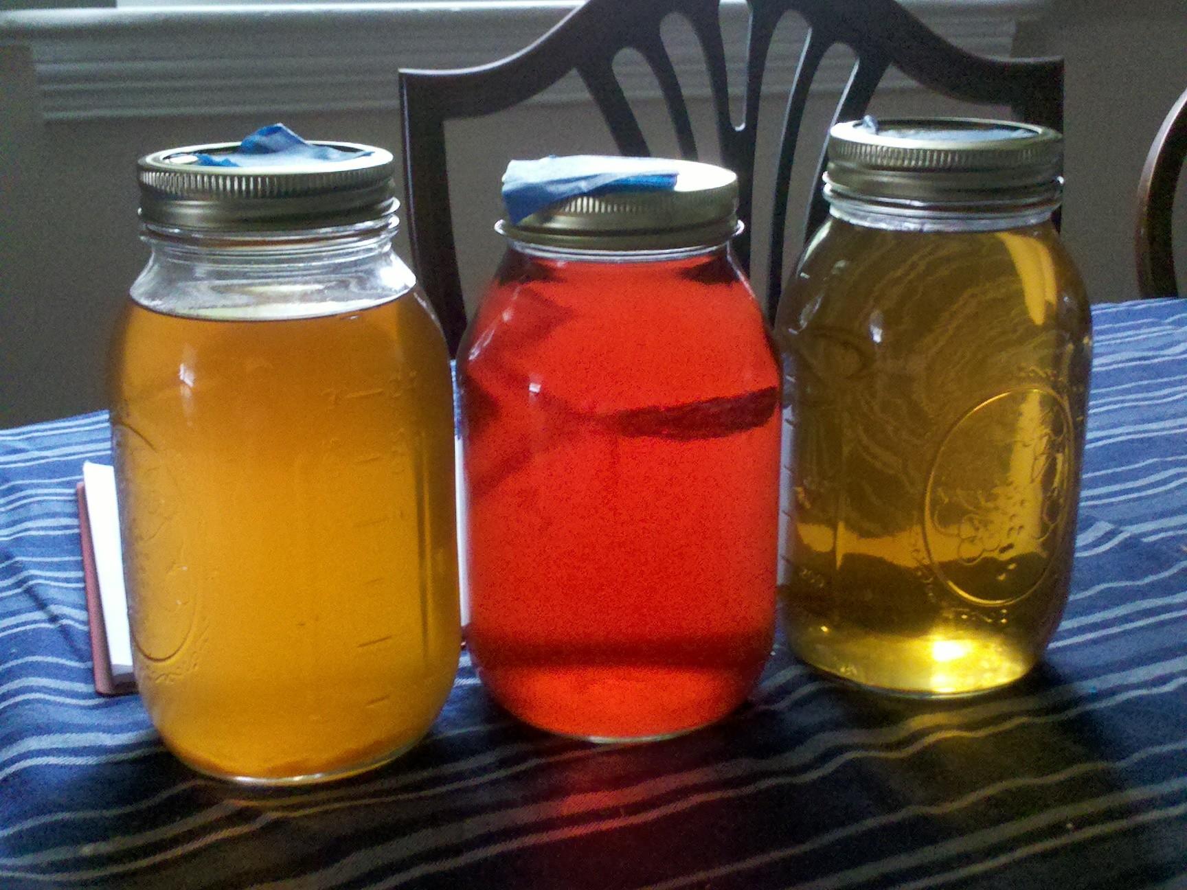 three mason jars with cordials