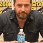 Richard Armitage at ComicCon with a bottle of water
