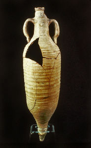 re-pieced grooved pottery wine amphora with chunk missing