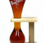 bulb-bottomed glass of Kwak beer in its wooden holder