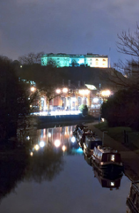Nottingham Castle up on Castle Rock, lit at night