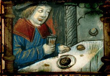Medieval man sitting at banquet with glass of hypocrasin his hand
