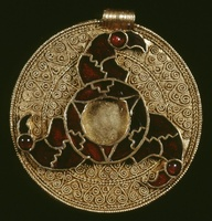 round pendant with three enamel ravens in 7th century Anglo-Saxon gold