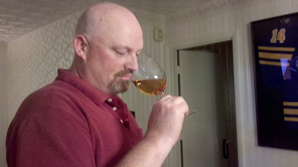 A man smelling the wine in his glass