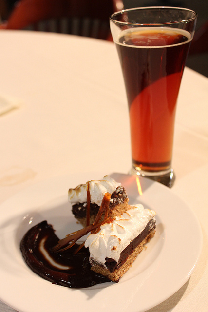 dessert in chocolate sauce and a glass of ale