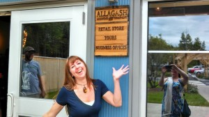 A woman in front of the Allagash front door sign