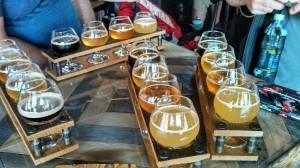 sets of four tulip glasses holding samples of Allagash beers