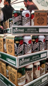 stack of 4-packs of Pilsner Urquell cans, recently redesigned