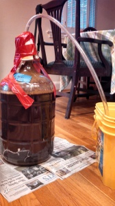 Full carboy with the stopper duct-taped down